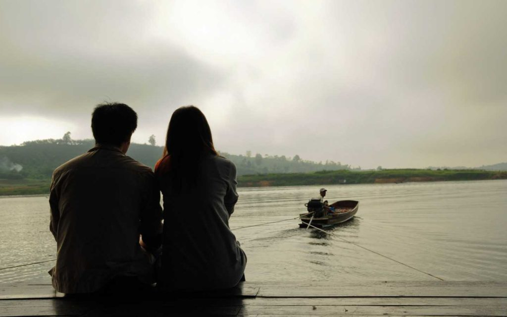 Couple Sitting nearby river